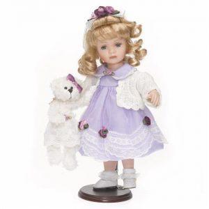 Porzellan-Puppe & Strickweste & Teddy